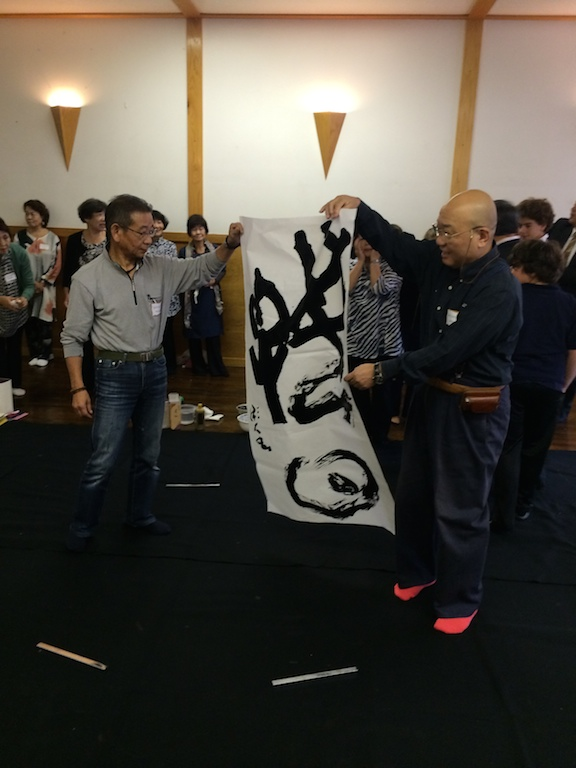 Japanese calligraphy (Shodo) masters hold a Scroll at the Japanese Culture Center in Chicago.