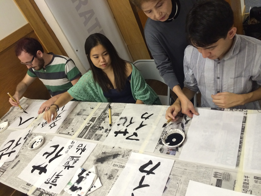 Japanese sensei (instructor) helps student at the Japanese Culture Center in Chicago.